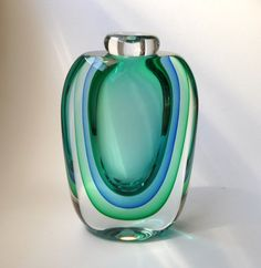 1980s Triple Sommerso Murano Glass Vase by Luigi Onesto for Oball (via Etsy). Such beautiful transparent color - separated so perfectly! - almost appearing to morph from a square to a round.
