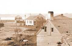 The church in the center of the photo is St. John The Baptist Catholic Church, Sullivan's Island 1865.  The first Mass celebrated in Saint John The Baptist was on June 22, 1845.  The cornerstone for present day Stella Maris Church was laid on January 18, 1869.  Stella Maris was dedicated on June 21, 1874, replacing the old St. John The Baptist Church. Sullivans Island, John The Baptist, Present Day, Catholic, Old Things, Saint John, Cabin, June 22, House Styles