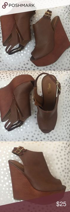 Charlotte Russe Platform Brown Wedges SZ 7 Simple brown wedge. Very light weight and perfect for last minute graduation shoe shopping! Charlotte Russe Shoes Wedges