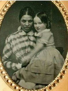 Slave who gave birth to her slave owners child from rape, then to be talked to badly by her own child not giving away that was her mother This picture is of a slave and the child she gave birth to being raised as white by the slave owners wife as she was childless... The children did not know of this situation so treated there own birth mothers  badly.