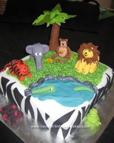 Homemade Jungle Animals Birthday Cake: I made this Homemade Jungle Animals Birthday Cake for a friend's 4 year old boy.  I got heaps of inspiration from this website and then mixed it with my