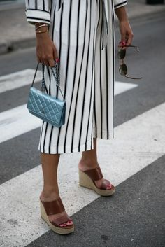 Summer Look: striped Jumpsuit, wedges and metallic Chanel Bag. Get inspirational Looks on: designdschungel.com