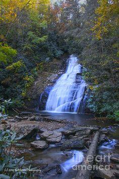 The vibrant colors of fall light up Shelton Creek Falls in North Georgia.