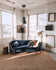 navy blue velvet sofa paired with an industrial chic loft. / sfgirlbybay