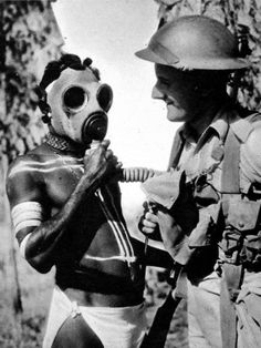 Aborigine Trying on a Gas Mask, Australia, Second World War