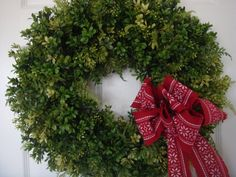 Christmas wreath, Christmas boxwood wreath, holiday boxwood wreath, boxwood decoration, holiday boxwood decoration, boxwood wreath, boxwood decor Beautiful 21 wreath filled with various types of boxwood and fern and finished with a lovely deep red bow (bow is removable). Will lend Holiday Wreaths, Holiday Decor, Boxwood Wreath, Bow Bow, Bows, Fern, Unique Jewelry, Handmade Gifts, Beautiful