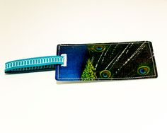peacock luggage tag recycled paper luggage tag with peacock feathers. $8.00, via Etsy.