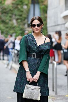 How To Dress Like An Italian Girl — 50+ Lessons Worth Knowing #refinery29  http://www.refinery29.com/2014/09/74945/milan-fashion-week-2014-street-style#slide-13  An off-the-shoulder look that's off-kilter in the best way.