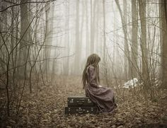 profile view woman sitting in the forest with fog. Fine Art Portrait Photography by Patty Maher