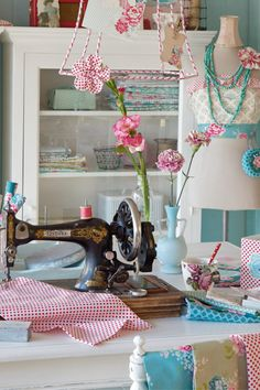 Beautiful hand crank singer type sewing machine. Vintage decor blue and white sewing quilting room.  Lovely. #creative #space