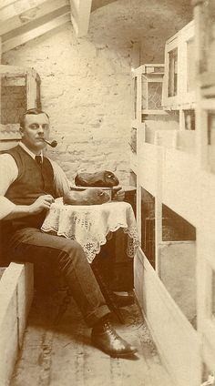 Vintage photo of man with guinea pig.