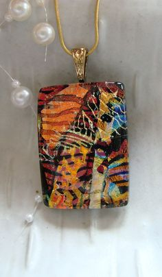 Dichroic Fused Glass Pendant, Copper, Red, Black, Gold, Necklace Included, One of a Kind. $28.00, via Etsy.