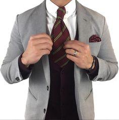 Stellar menswear ensemble complete with a classic regimental tie in deep burgundy.