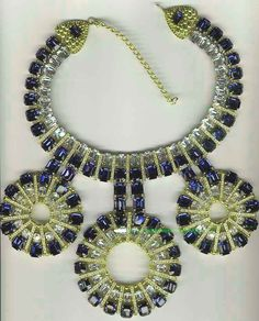 Coppola e Toppo necklace with 3 circular pendants.  Made for Valentino in 1970, it is constructed of gilt-stamped metal, sapphire-blue faceted Swarovski crystals, rhinestones and gilt metal beads.  According to Ginger Moro, the necklaces came in a single, double and triple circle version.