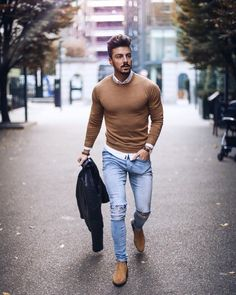 Handsome male model wearing blue jeans, brown sweater and brown shoes - #blue #brown #Handsome #jeans #male #model #shoes #sweater #wearing