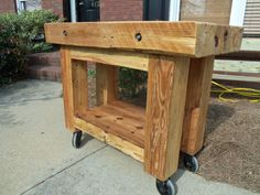 chopping block island made from reclaimed pine beams