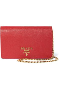 Prada Red textured-leather (Calf) Snap-fastening front flap Comes with dust bag Weighs approximately 0.7lbs/ 0.3kg Made in Italy