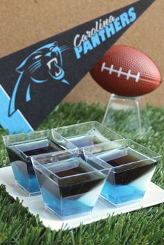 Carolina Panthers Jell-O Shots (3 oz. box berry blue Jell-O 4 envelopes Knox plain gelatin  3 cup vodka  1 cup milk 1/4 cup granulated sugar 3 1/2 Tbs lime Jell-O powder 3 1/2 Tbs grape Jell-O powder Black food coloring)