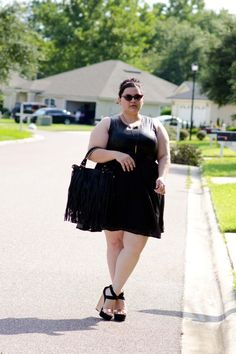 Blogger Kirstin in a Deb Shops leather and chiffon black dress