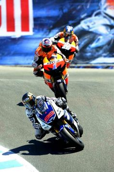 Jorge Lorenzo, Casey Stoner and Dani Pedrosa enter the Corkscrew at Laguna Seca - Moto GP 2012