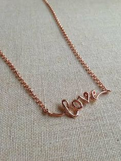 """Rose Gold """"Love"""" script necklace on 16 inch rose gold chain. Available now, just in time for Valentine's Day!"""