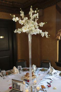 Tall white wedding flower centerpiece.    Photo by @Jess Mccrea-Stauffer via www.j3designz.com