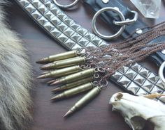 bullet necklaces // .223 brass copper bullet by snooeisen on Etsy