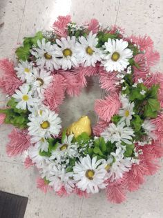Pink wreath with daisies and yellow bird wreath