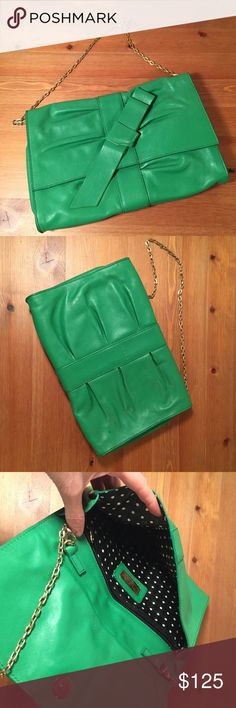 """Furla Made in Italy Genuine Leather Green Bag Furla Made in Italy Genuine Leather Green Bag  I might have worn it once! It's a beautiful Furla green ribbon leather bag. Perfect size for a shopping day or a classy evening at the opera. It's more of a clutch handbag but it can be worn on the shoulder thanks to its gold chain. It's in great condition; the only noticeable sign of wear is the small black stain at the back of the bag (see pictures) Size is approximately 10"""" x 7"""" x 1"""" Furla Bags"""