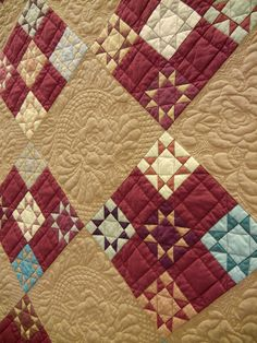 """Lancaster Rose, 88 x 88"""", by Janet Davis (Colorado). Inspired by an 1895 Ohio Amish quilt. Photo by Quilt Inspiration."""