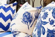 Blue and white protea cushions.