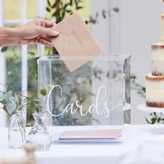 This Clear Acrylic Box Looks Amazing When Filled with Cards from the Guests! Place this acrylic box at the side of the wedding to let your guests drop in their cards and gifts! It features a cursive font phrase saying 'Cards' and when filled, it becomes an eye-catching decoration in itself! Product Details Pack Size: 1 Dimensions: 24 x 24.5 x 24cm Material: Acylic Wedding Card Post Box, Gift Table Wedding, Wedding Boxes, Wedding Signs, Wedding Cards, Rustic Wedding, Card Holder Wedding, Classic Wedding Decor, Wedding At Home
