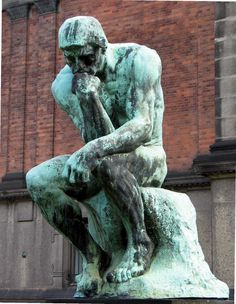 Dante Alighieri - believed to be The Thinker contemplating as he looks down upon hell. Statue by Rodin