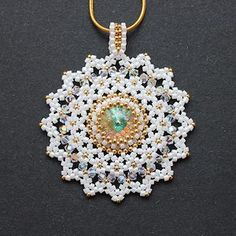 "Pendant ""Snowflakes"" Tutorial - 2 ------------ For the work we need: Delica or Toho trezhers size 11/0; Japanese seed beads size 15/0; Rivoli 12 mm - 1 pc.; bicones and Czech faceted bead size 3 mm-- 32 pcs."
