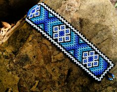Beautiful blue and white bracelet made by Huicoles from Mexico. Length: 7 inches  Width: 1.5
