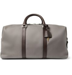 Clipper Leather-Trimmed Canvas Holdall Bag by Mulberry. $1,195, available at Mr. Porter. Classic style, endless versatility, one of the British accessory powerhouses best sellers.