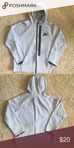 Boys hoodie Grey fleece Nike hoodie. Soft warm and light fabric with rubbed cuffs and elastic hem offers stay out for. Multi panel hood, split kangaroo pockets and an extra lined chest pocket, which is great for storing money, phone and headphone cords! Nike Shirts & Tops Sweatshirts & Hoodies
