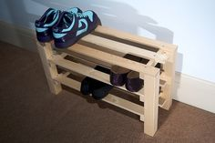 DIY Shoe rack for front and back doors. Probably would work better than the metal ones I have.