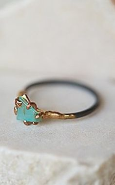 love!!!!! its not a diamond but I love this ring. I really like the two tone band, the shape of the stone and the color of the stone. if this had a sick grey diamond I would melt.