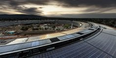 "A friend of Steve Jobs has converted a ranch to a ""solar"" farm and will supply Apple Park clean energy, CNBC reports. Norman Foster, Sede Da Apple, Centro Fitness, Apple Headquarters, Guggenheim Bilbao, Reflection Photography, Photography Ideas, Apple New, Workplace Design"