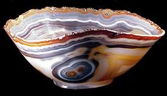 Agate Bowl, Idar-Oberstein, Germany--The bowl was carved from a block of Brazilian agate before WWII. The carver retained the small quartz crystals which had formed on the surface of the agate. 10-1/4x8x5 inches