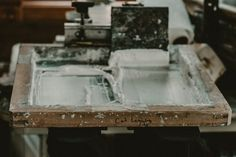 """Now it's time to transfer the design to fabric through the screen. """"The screens are basically like a big stencil, you can put any color ink on there,"""" Charles says, adding that she's had the same screens for about three years now, which she simply cleans with water after each use."""