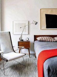 danish interior design gray bedroom with red blanket