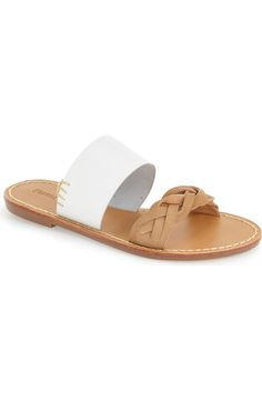 A braided strap contrasts with the smooth leather of this flat-soled slide sandal outlined in bold contrast stitching.