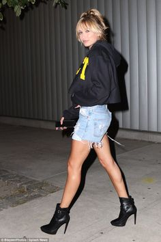 Striding out: Hailey, 18, flashed her slim pins in ripped denim shorts and ankle boots...