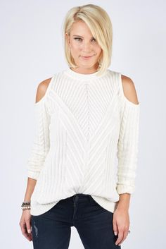 This cold shoulder sweater brings a little sexiness to a conservative cable knit.