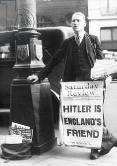 Newspaper vendor selling pro-Hitler papers (b/w photo)
