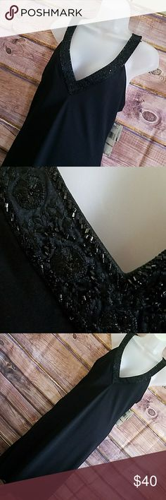 New Jones New York black beaded dress ladies 12 New with tag Jones New York beaded Seychelles Island dress. Ladies size 12. Retails for $160. Gorgeous beaded trim around neckline and on back.  The dress is 100% polyester in the straps are 100% silk. It's zips up the back. When laid flat the approximate measurements are 21 inches from armpit to armpit and from armpit to hemline is 36 inches. Jones New York Dresses Midi