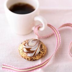 Cappuccino Love Bites  For this simple topper, press a striped chocolate kiss into each baked cookie while it's still warm. After the chocolate softens, swirl it with a knife.  See Cappuccino Love Bites recipe