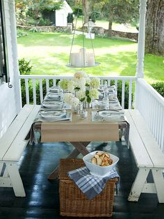 On this small porch, a slim folding table is paired with white wooden benches that allow for several people to share a meal. A painted black floor adds contrast to the white benches, railing, and siding of the house and a contemporary light fixture gives the space a candlelit glow at night. http://www.bhg.com/home-improvement/porch/outdoor-rooms/casual-porch-dining/?socsrc=bhgpin041415casualporchdining&page=6